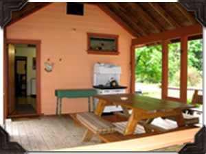There is a large covered veranda to enjoy the sights and sounds of nature at your doorstep.