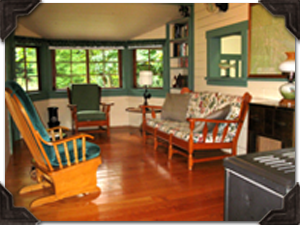 Features a cozy living room with a gas stove and a bay window looking out to the cowichan river.